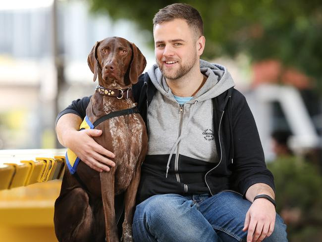 Jeremy Medlock with his psychiatric assistance dog, Frankie. Picture: Richard Dobson