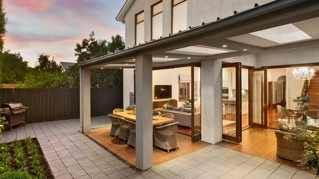 The living room at 72 Rossmoyne St, Thornbury opens to the low-maintenance courtyard.