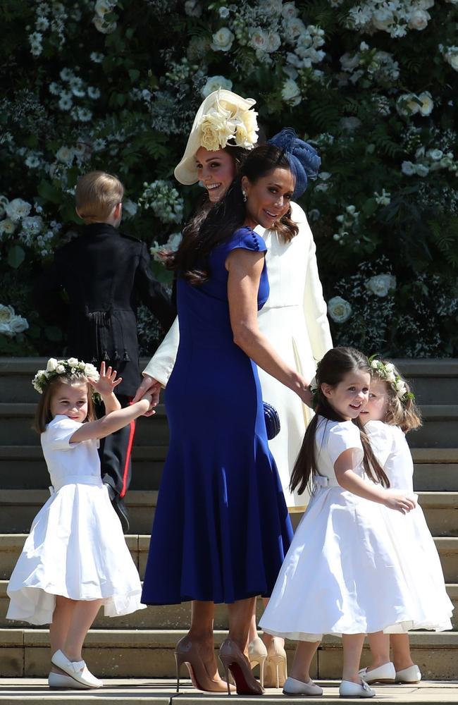 Britain's Catherine, Duchess of Cambridge (L) and Meghan Markle's friend, Canadian fashion stylist Jessica Mulroney hold bridesmaids hands as they arrive for the wedding ceremony. Picture: AFP PHOTO / POOL / Jane Barlow