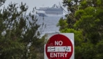 The Ruby Princess cruise ship is seen from Kurnell National Park in Sydney, Thursday, April 2, 2020. There are more than 450 COVID-19 infections linked to cruise ships, including 340 cases from the Ruby Princess and 74 from the Ovation of the Seas. (AAP Image/Craig Golding) NO ARCHIVING