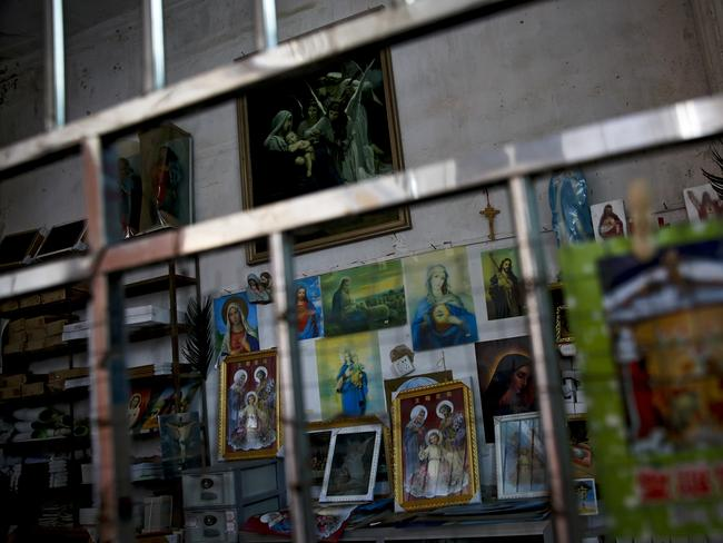 Catholic religious paintings and Bibles are displayed behind bars at an underground Catholic Church in Jiexi county in south China's Guangdong province. Picture: AP