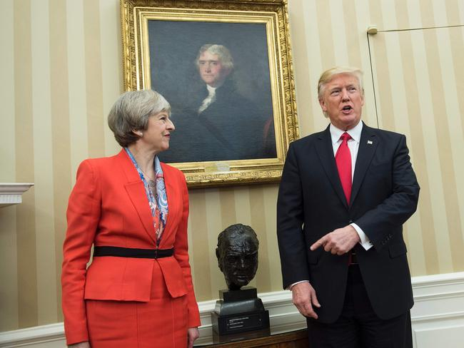 Theresa May and Donald Trump next to a bust of his hero, former British Prime Minister Winston Churchill. Picture: AFP/Brendan Smialowski