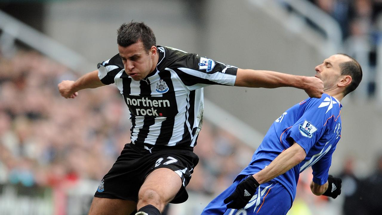 Steven Taylor of Newcastle United hits out at Martin Petrov of Bolton Wanderers.