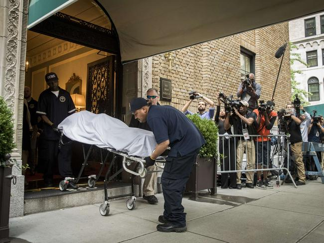the body of fashion designer kate spade is removed from her apartment building in manhattan