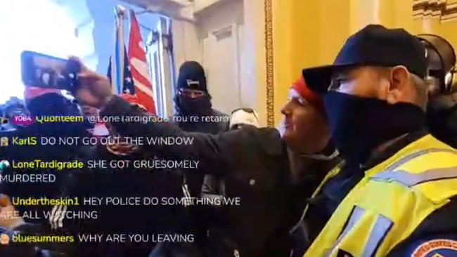 Capitol rioter seen taking a selfie with a Capitol Police officer.