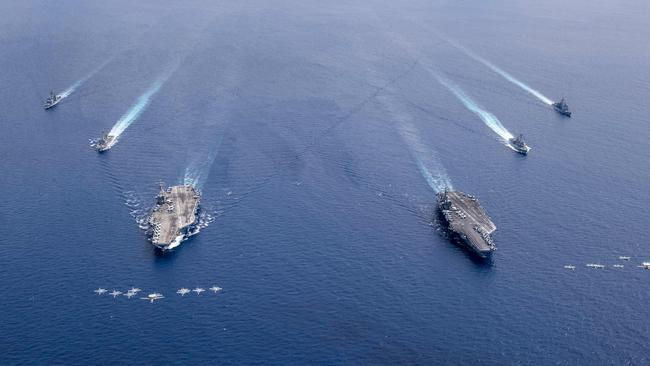 The carrier strike groups USS Nimitz, right, and USS Ronald Reagan in the Indo-Pacific on July 6. Picture: US Navy via AFP