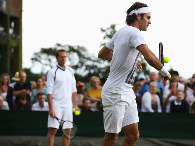 Roger Federer practices with his coach, Stefan Edberg.