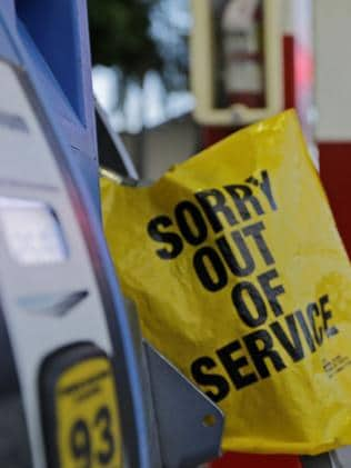 A gas pump is covered after a station ran out of petrol in Miami. Picture: AP Photo/Alan Diaz.