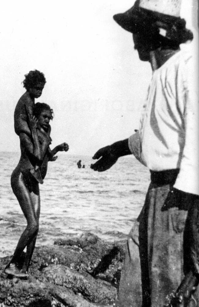 An Aboriginal woman backs away from a white man holding a gun on Bentinck Island, Queensland, in 1901. Picture from the book 'North Of Capricorn — The Untold Story of Australia's North' by Henry Reynolds.