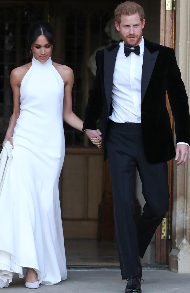 Prince Harry and meghan Markle on the way to their wedding party. Picture: MEGA