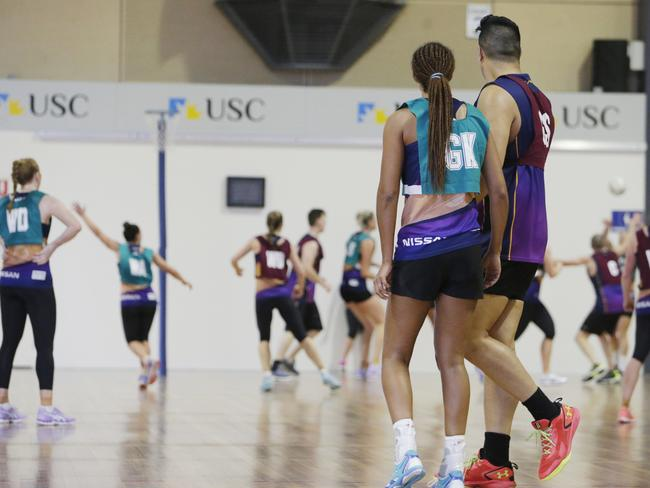 Geva Mentor stands next to the 215cm 'Gentle Giant' Junior Levi during a practice match. Picture: Lachie Millard