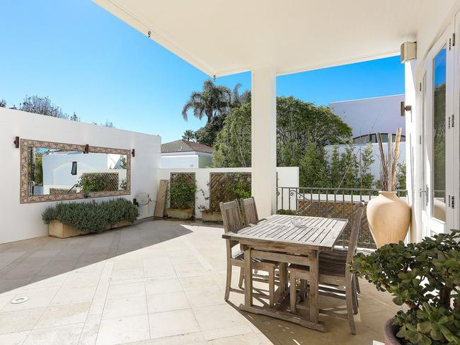 1/39 Wunulla Rd, Point Piper has outdoor entertainment areas (above) and a shared jetty (below).