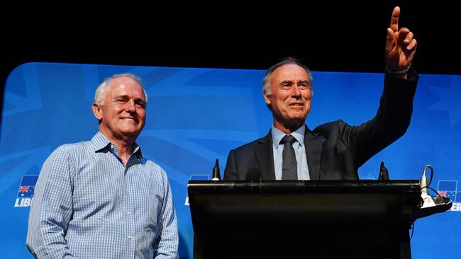 Prime Minister Malcolm Turnbull (left) and newly elected Liberal member for Bennelong John Alexander celebrate. Picture: AAP