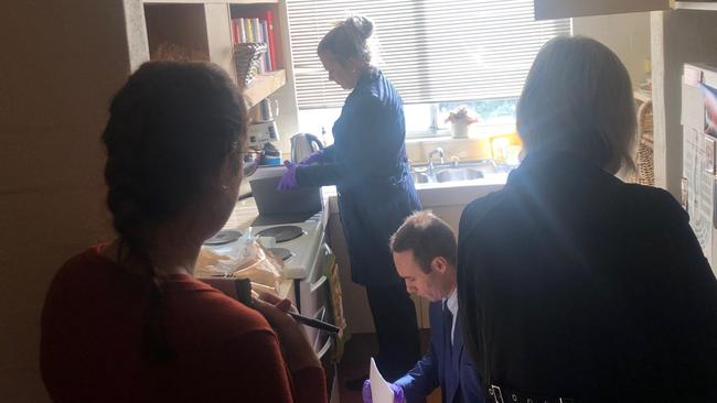 Federal Police going through Annika Smethurst's kitchen. Picture: Supplied