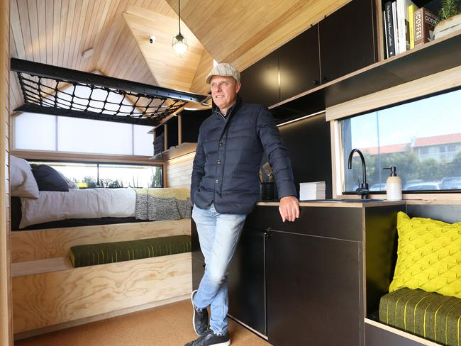 Could you live in a tiny home? Mr Maddison inside the one he designed. Picture: Mark Wilson