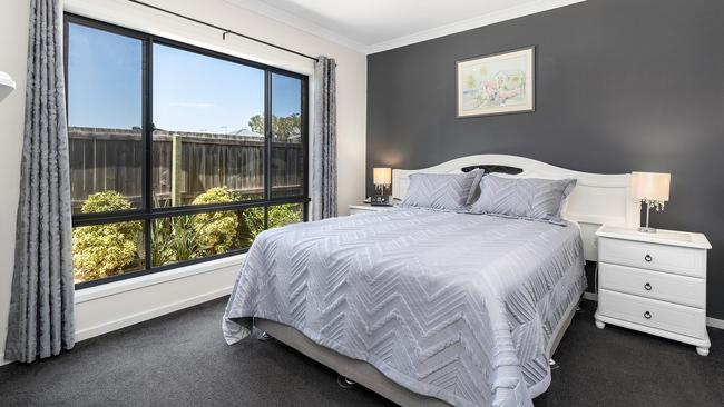 The bedrooms are modern and have a feature wall.