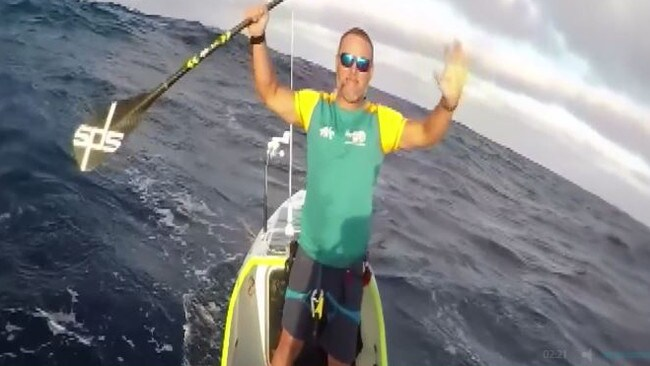 Antonio de la Rosa celebrates as he approaches Oahu at the end of the three-month journey at sea.