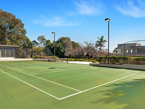 The tennis court.