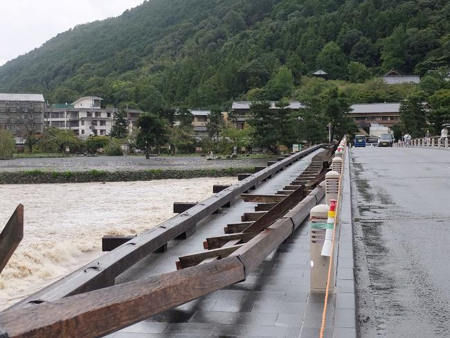A toppled balustrade of the landmark Togetsu bridge is seen in Kyoto. Picture: AFP