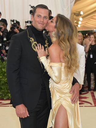 Gisele Bündchen gives husband Tom Brady a kiss at the 2018 Met Gala. Picture: Getty