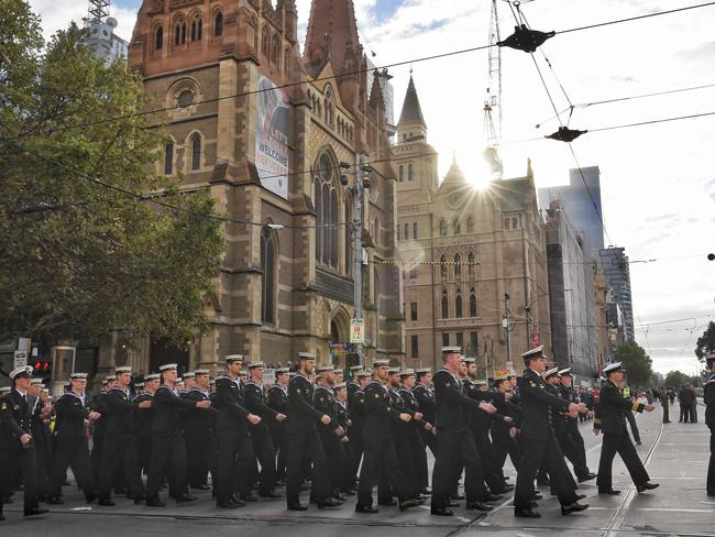 Marching down Swanston St towards the Shrine. Picture: Jason Edwards