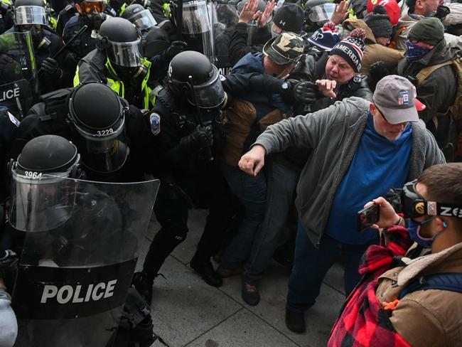 Riot police push back a crowd of supporters of US President Donald Trump after they stormed the Capitol building on January 6 in Washington, D.C. Picture: Roberto Schmidt/AFP
