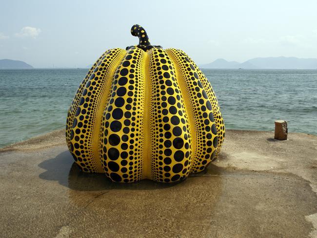Artist Yayoi Kusama sculpture 'Pumpkin' on the island of Naoshima, Japan.