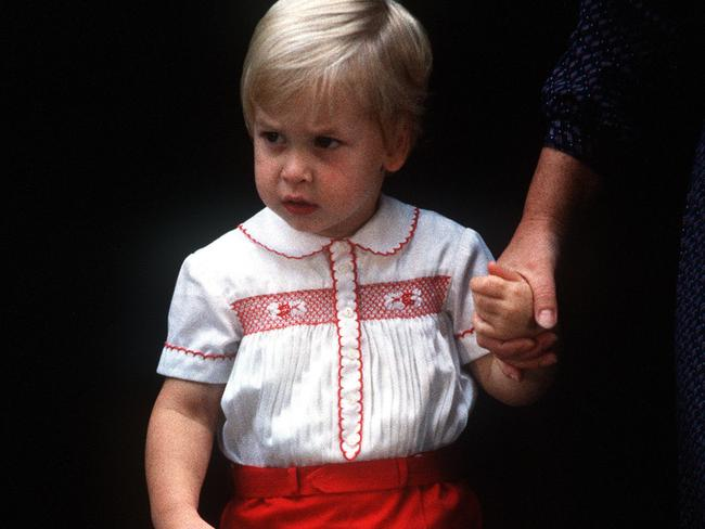 A young Prince William visits Prince Harry with his nanny on September 16, 1984.