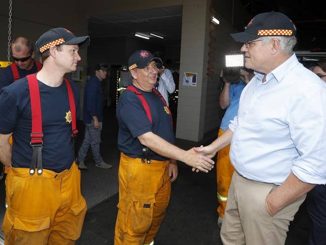 Prime Minister Scott Morrison meets crews from Woodside Country Fire Service in Woodside, South Australia, on Christmas Eve. Picture: AAP Image/Kelly Barnes