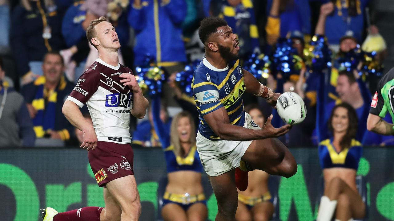 Maika Sivo of the Eels celebrates scoring his third try against Manly