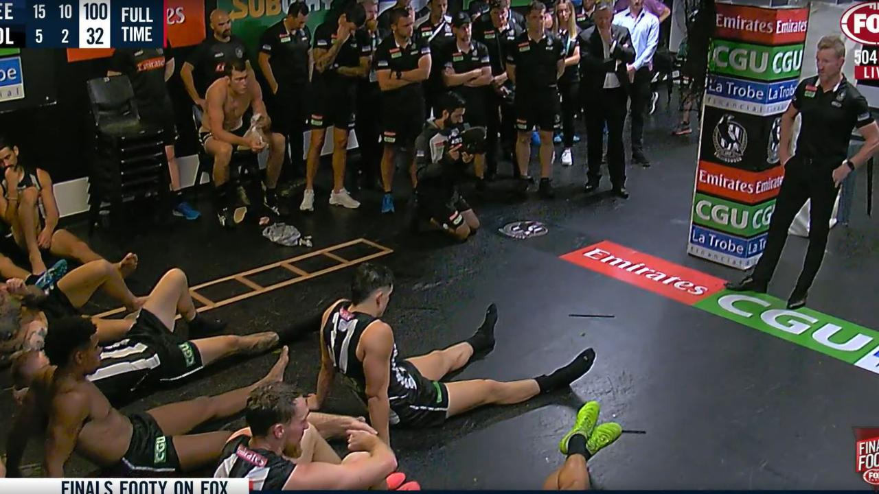 Nathan Buckley talks to his players after their massive semi-final loss to Geelong.