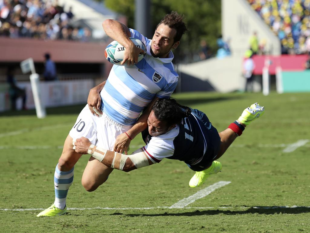 Argentina's Nicolas Sanchez runs to score a try as he is tackled by United States' Mike Te'o during the Rugby World Cup Pool C game at Kumagaya Rugby Stadium between Argentina and the United States in Kumagaya City, Japan, Wednesday, Oct. 9, 2019. (AP Photo/Eugene Hoshiko)