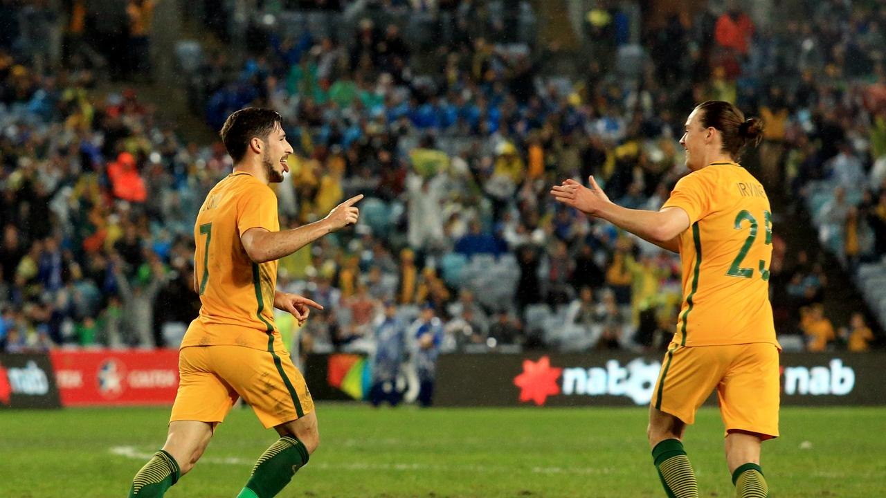 Socceroos Mathew Leckie celebrates his goal with Tom Rogic