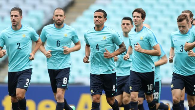 Socceroos players warm up during a training session.