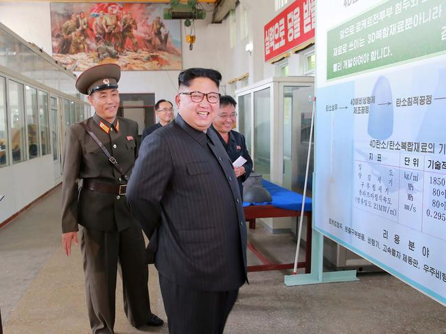 Kim Jong-un takes a tour of the Chemical Material Institute of the Academy of Defence Science. Picture: AFP/KCNA via KNS