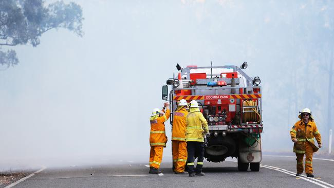 Fire crews at Rainbow Flat on the mid-north coast. Picture: Peter Lorimer.