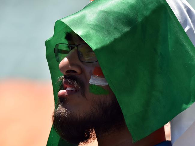 The Indian flag helped protect one fan from the scorching sun on Thursday. Photo: PETER PARKS / AFP