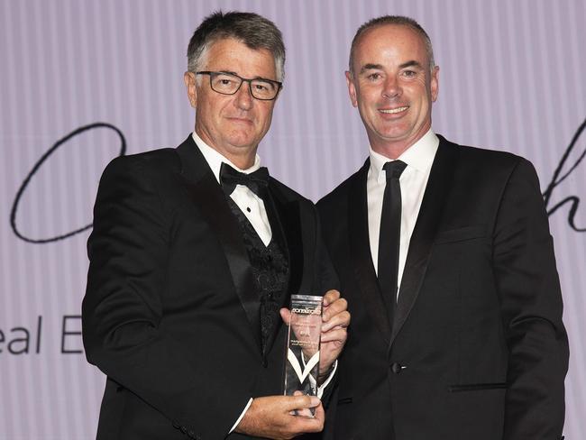 John Cunningham receives his award from REIA President Adrian Kelly (right).