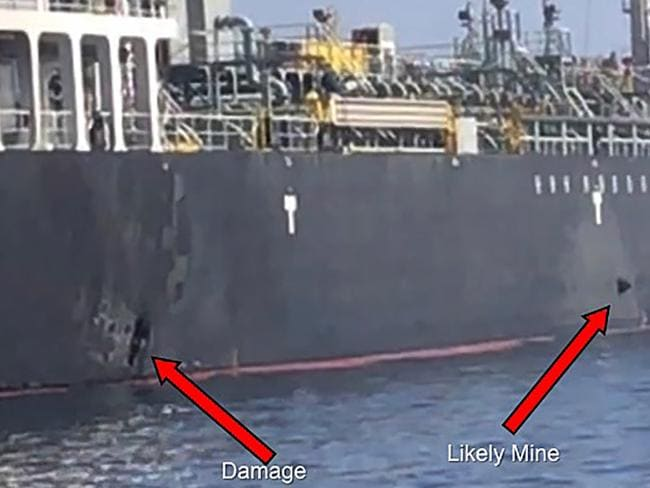 This handout power point slide provided by U.S. Central Command damage shows an explosion (L) and a likely limpet mine can be seen on the hull of the civilian vessel M/V Kokuka Courageous in the Gulf of Oman. Picture: AFP