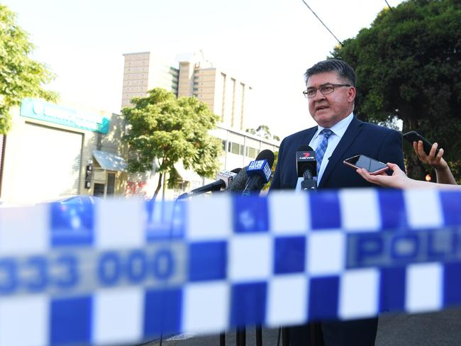 Homicide Squad Sergeant Sol Solomon speaks to media outside Melbourne Pavilion in Kensington. Picture: James Ross/AAP