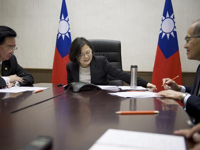 In this photo released by Taiwan Presidential Office President Tsai Ing-wen, centre, flanked by National Security Council Secretary-General Joseph Wu, left, and Foreign Minister David Lee, speaks with US President-elect Donald Trump through a speaker phone in Taipei. Picture: Presidential Office via AP