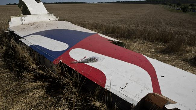 Clues ... The damaged fuselage of the Malaysia Airlines' Boeing 777. Picture: Ella Pellegrini
