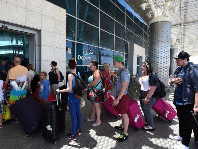 Going home ... British tourists leave Tunisia at the Enfidha International airport. Picture: AFP