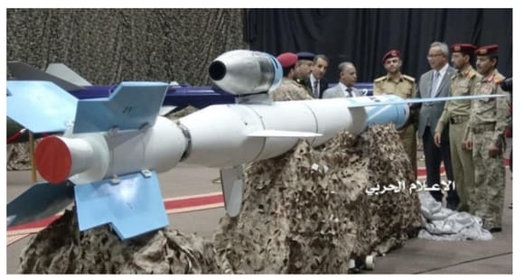 Yemeni Houthi officials stand around a Quds 1 (Jerusalem 1) cruise missile at a July event.