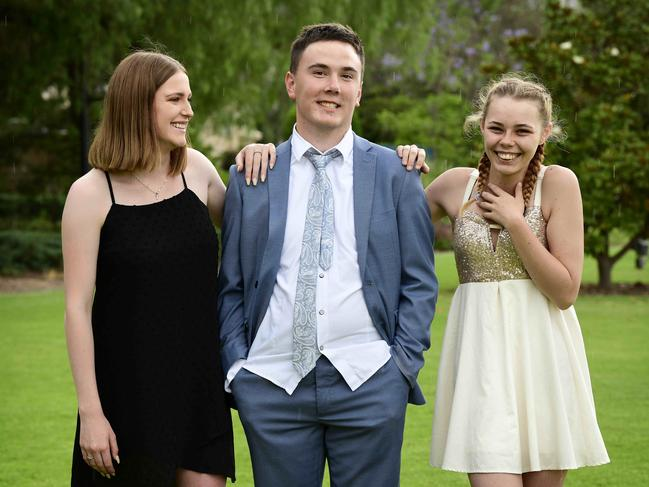 STRIVING: High school graduates Tahmika Richardson, Micheal Robertson and Indiana Reese-Loffler at Government House. Picture: Bianca De Marchi