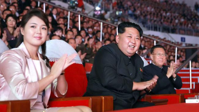 Kim Jong-un's wife Ri Sol-Ju (left) is just as mysterious as the North Korean leader. Picture: AFP Photo/KCNA via KNS