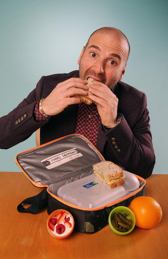 Snack attack ... George Calombaris eats his way through his son James' lunch box. Picture: Alex Coppel.
