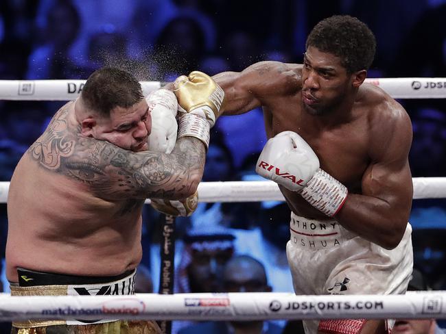 Joshua lands a shot on Ruiz. (AP Photo/Hassan Ammar)