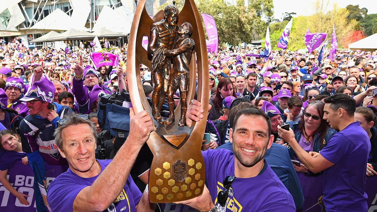 Cameron Smith and Craig Bellamy of the Storm hold up the NRL premiership trophy in 2017