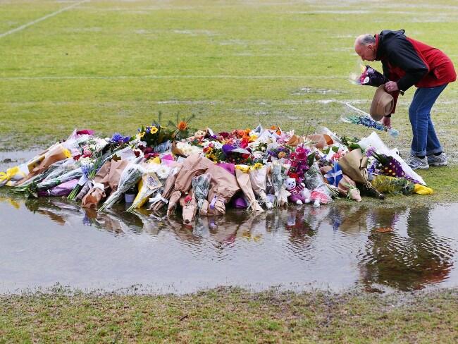 Tributes to Eurydice Dixon are laid at Princes Park in Melbourne. Photo: Michael Dodge/Getty Images